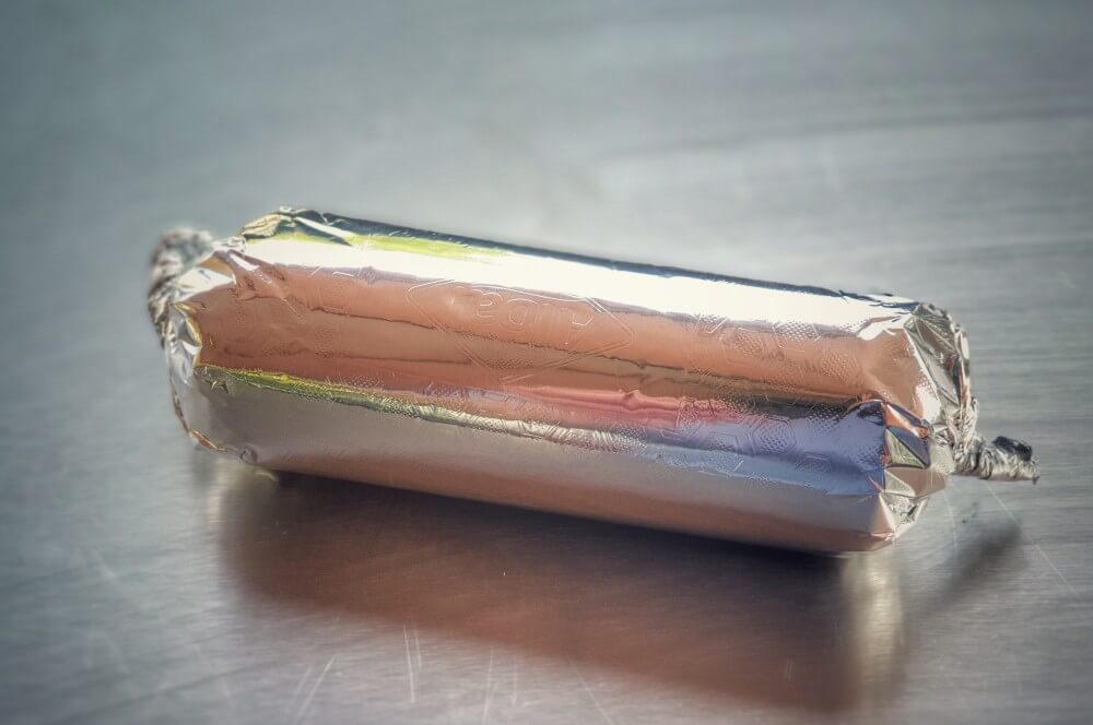Die Butter wird aufgerollt limettenbutter-Limettenbutter mit Koriander 03-Limettenbutter mit Koriander